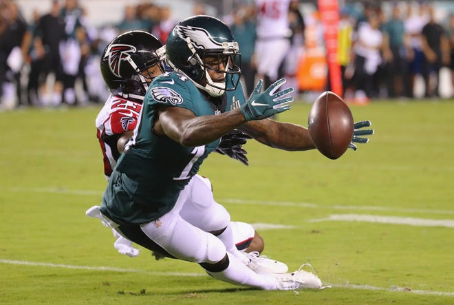Eagles receiver Mike Wallace tries to make a catch against the Falcons in the teams' season-opener in September.