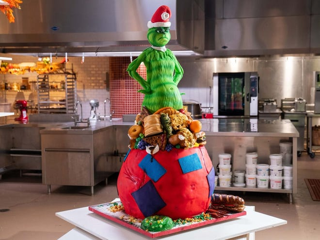 The Grinch frowns from atop the winning cake created by Columbus' Timbo Sullivan and Chillicothe's Sarah Myers.