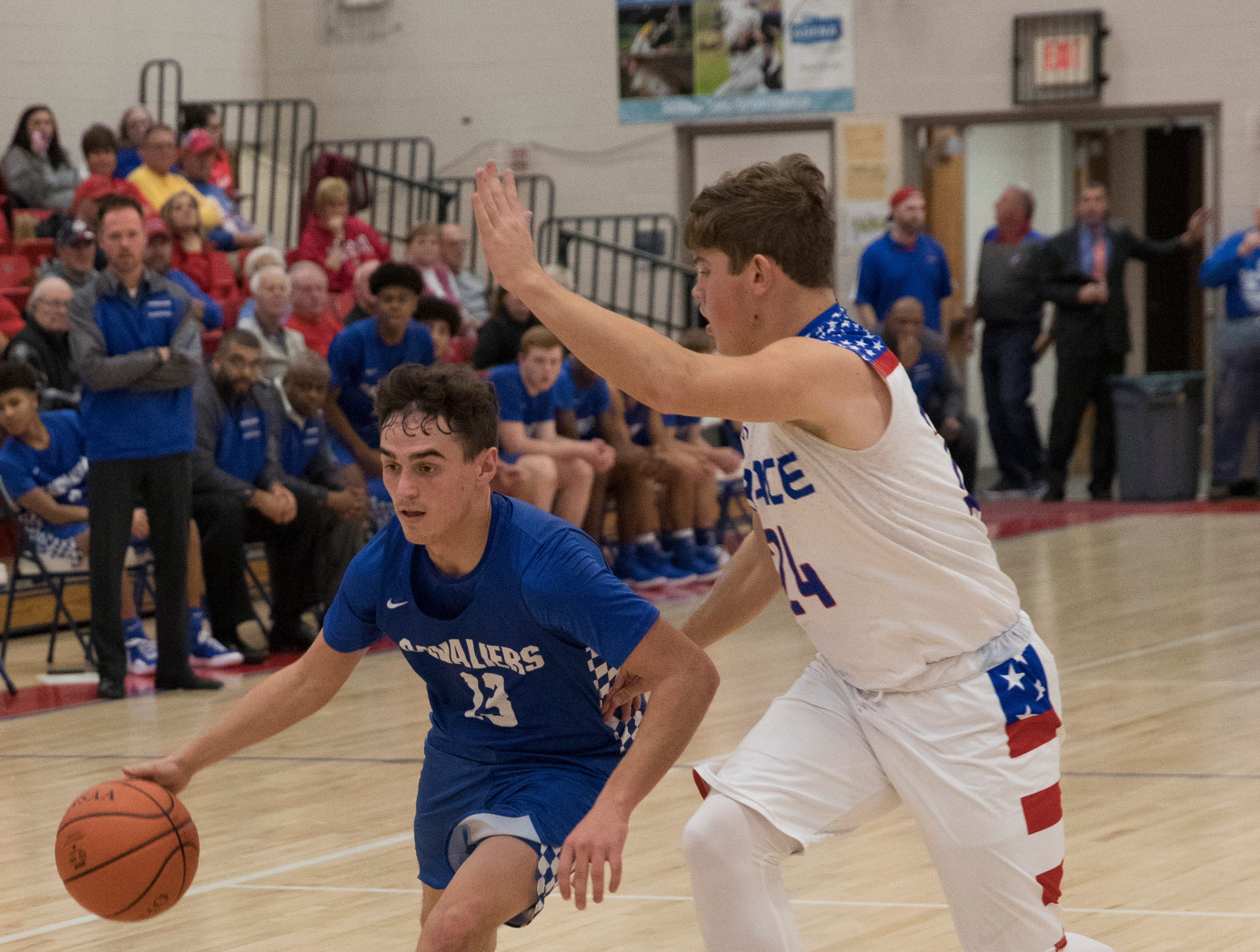 Chris Postage looks for an opening to pass during Chillicothe's game against Zane Trace Tuesday night at Zane Trace High School. The Pioneers defeated the Cavaliers 45-33.