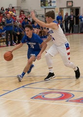 Chris Postage looks for an opening to pass during Chillicothe's game against Zane Trace.