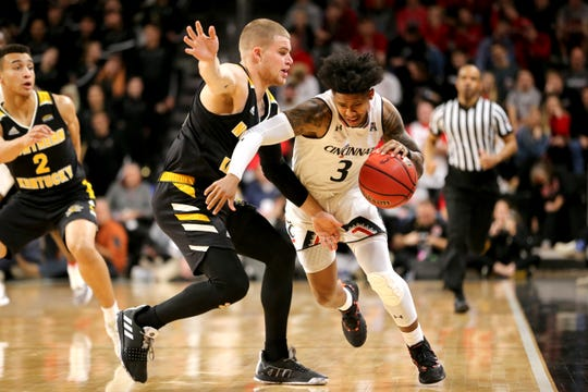 Cincinnati Bearcats guard Justin Jenifer (3) pushes the ball up the sidelines as Northern Kentucky Norse guard Tyler Sharpe (15) defendsin the second half of an NCAA college basketball game, Tuesday, Dec. 4, 2018, at Fifth Third Arena in Cincinnati.