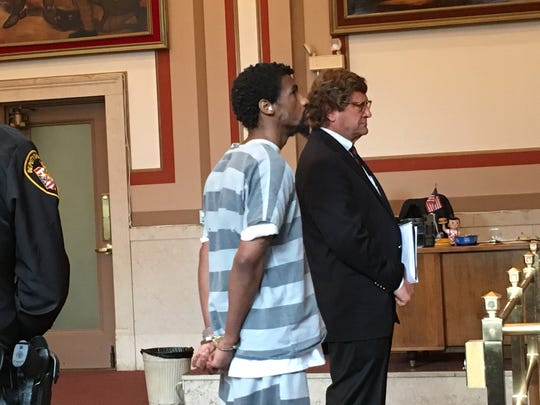 Anthony B. Smith Jr. stands next to his attorney, Thomas Koustmer, in Hamilton County Common Pleas Court Wednesday. Smith was found competent to stand trial in the June 22 attack of a pregnant woman on Riverside Drive.