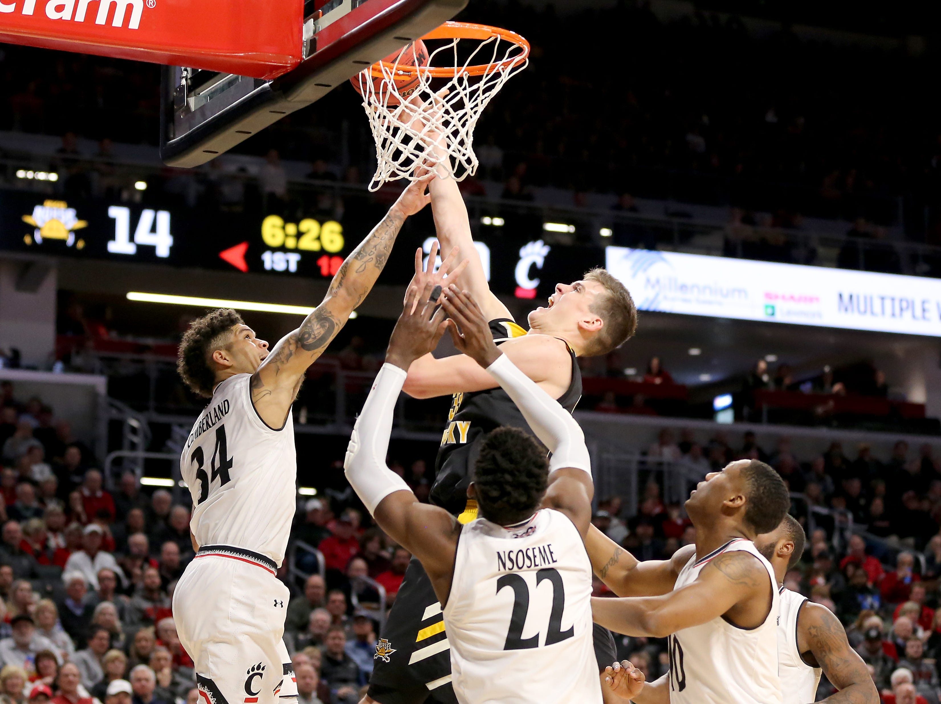 Northern Kentucky Norse center Chris Vogt (33) goes up for a shot in the first half of an NCAA college basketball game against the Cincinnati Bearcats, Tuesday, Dec. 4, 2018, at Fifth Third Arena in Cincinnati.
