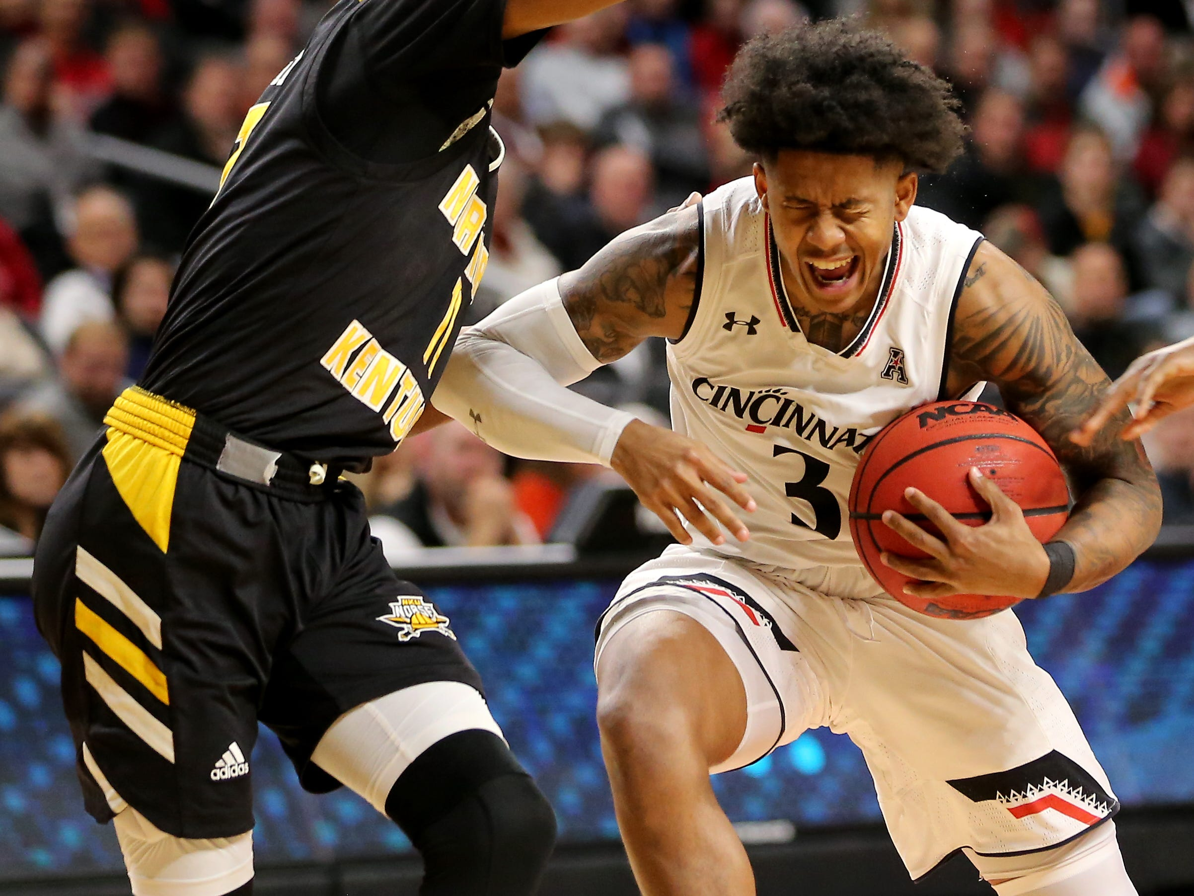 Cincinnati Bearcats guard Justin Jenifer (3) reacts after being fouled on his way to the basket in the second half of an NCAA college basketball game against the Northern Kentucky Norse, Tuesday, Dec. 4, 2018, at Fifth Third Arena in Cincinnati.