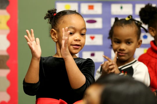 Students engage in a learning activity Wednesday in a Head Start classroom at the Cincinnati-Hamilton County Community Action Agency in Bond Hill.