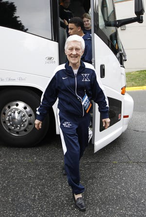 Sister Rose Ann Fleming, Xavier University's academic advisor coordinator, gets off the bus along with the team as they head to practice in preparation for their 2012 NCAA second round tournament game against Notre Dame in Greensboro, North Carolina. Former XU players James Posey and David West both named Fleming as a major influence on their lives.