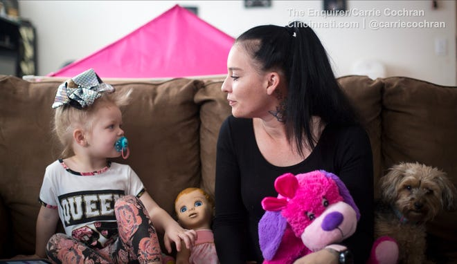 Ava, pictured in March, listens to her mom, Meichelle Hunley of Northern Kentucky. Hunley adopted Ava, who suffered from neonatal abstinence syndrome, or opioid withdrawal, at birth. Ava's speech was delayed, though her motor skills were on target.