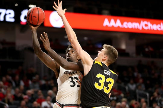 Cincinnati Bearcats center Nysier Brooks (33) rises for a shot as Northern Kentucky Norse center Chris Vogt (33) defends in the second half of an NCAA college basketball game, Tuesday, Dec. 4, 2018, at Fifth Third Arena in Cincinnati.