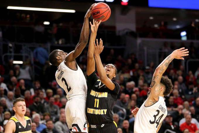 Cincinnati Bearcats guard Keith Williams (2) blocks a shot by Northern Kentucky Norse guard Jalen Tate (11) in the first half of an NCAA college basketball game, Tuesday, Dec. 4, 2018, at Fifth Third Arena in Cincinnati.