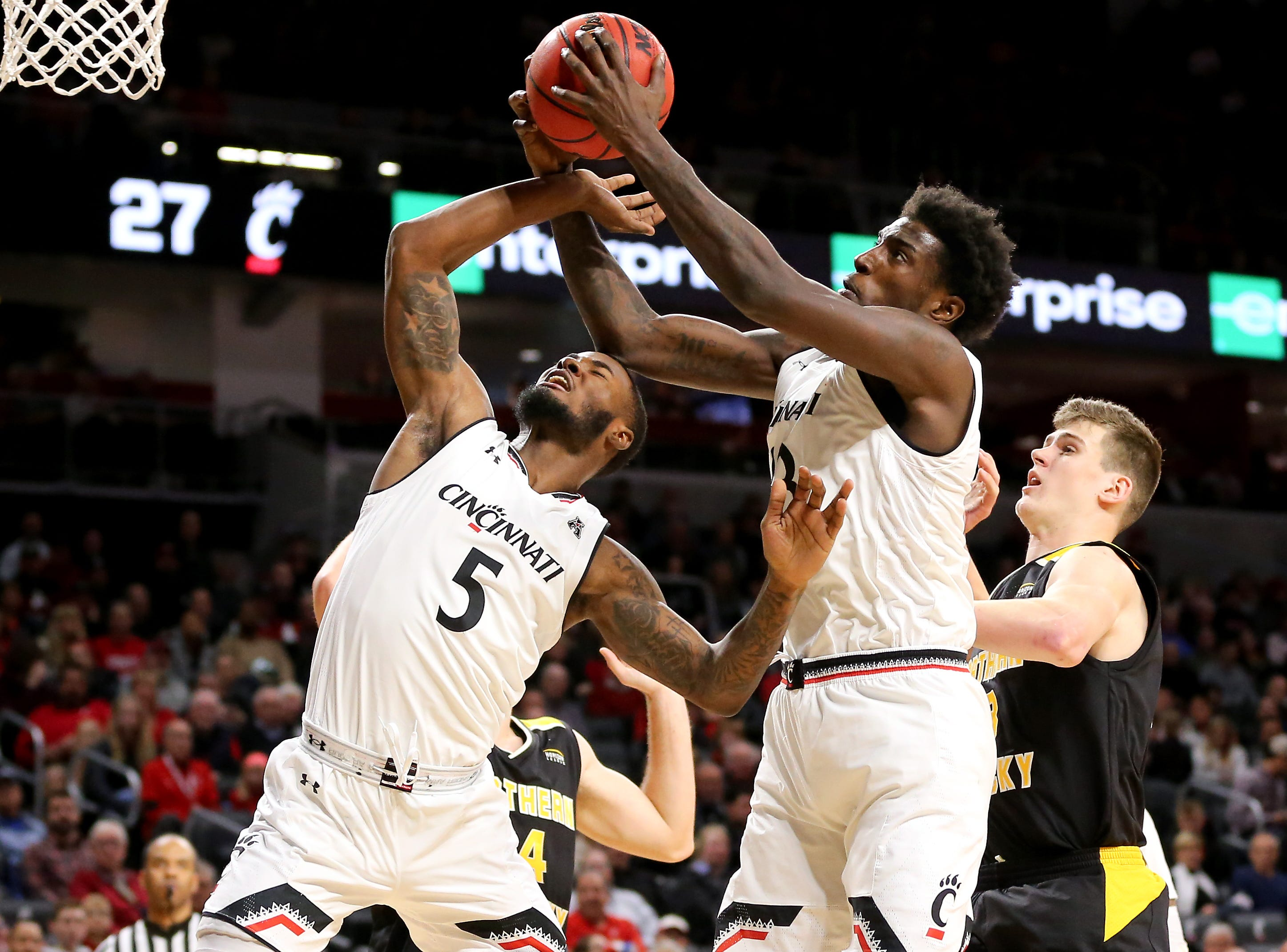 Cincinnati Bearcats center Nysier Brooks (33) rebounds the ball in the first half of an NCAA college basketball against the Northern Kentucky Norse, Tuesday, Dec. 4, 2018, at Fifth Third Arena in Cincinnati.