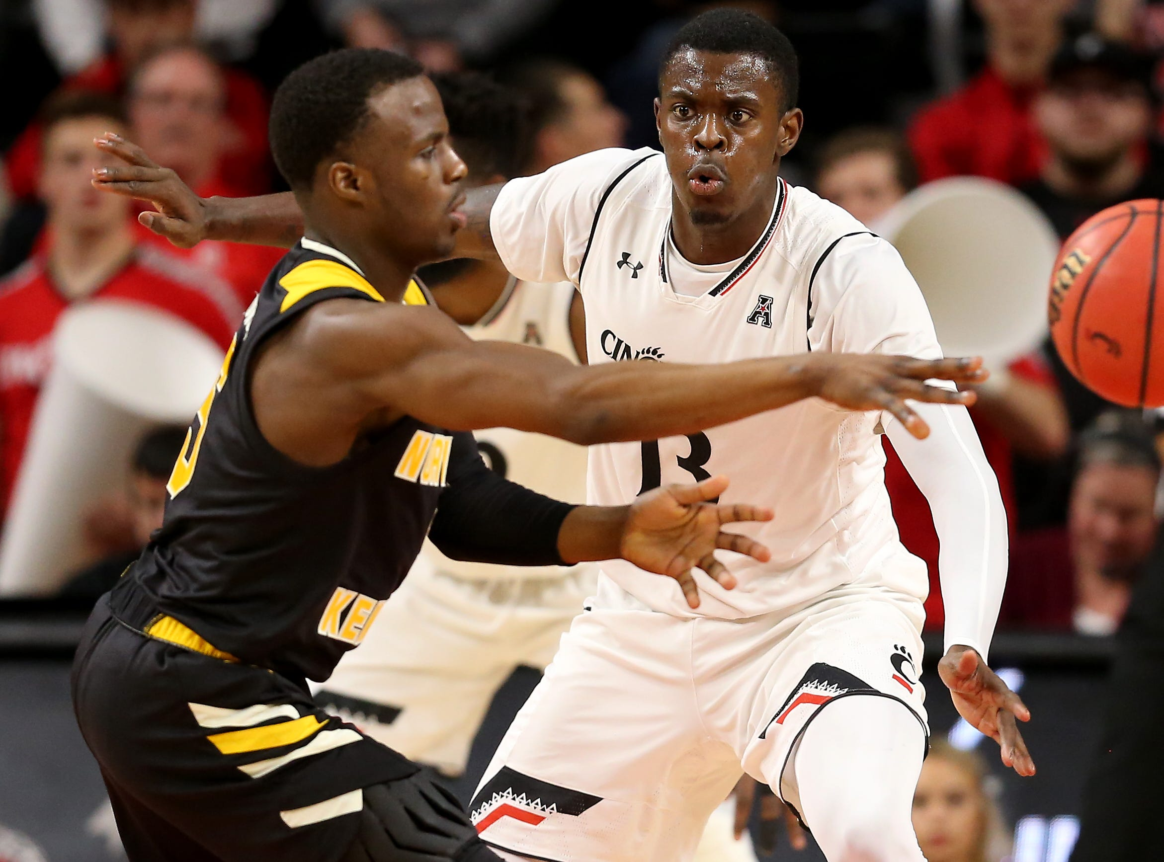 Cincinnati Bearcats forward Tre Scott (13) defends on Northern Kentucky Norse guard Zaynah Robinson (5) in the second half of an NCAA college basketball game, Tuesday, Dec. 4, 2018, at Fifth Third Arena in Cincinnati.