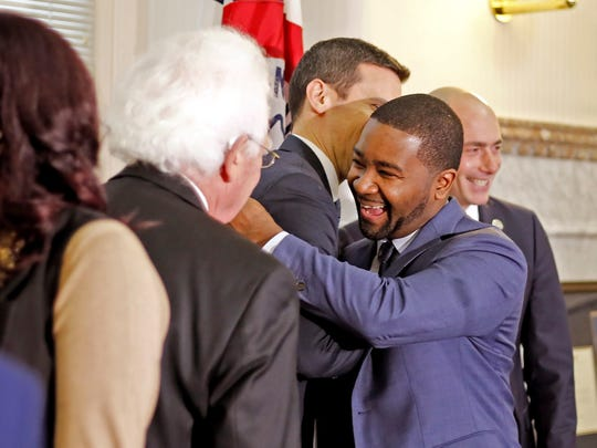 Patrick Duhaney embracing P.G. Sittenfeld Wednesday after Duhaney was nominated to become the permanent city manager for the City of Cincinnati.