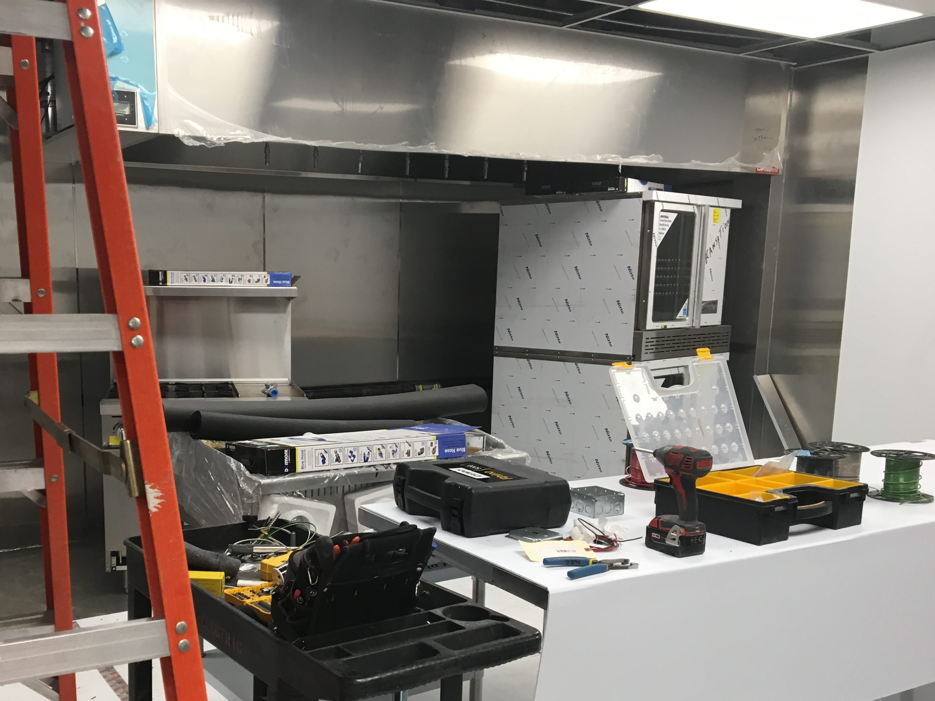 The cafeteria features a full kitchen.
