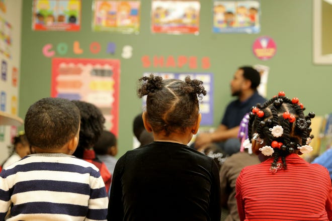 A group of students participate in learning exercises with teachers Ryan Williams and LaTrese Cowan, Wednesday, Dec. 5, 2018, in a Head Start classroom at Community Action Agency in Bond Hill.
