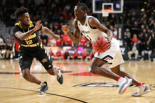 Cincinnati Bearcats guard Keith Williams (2) drives to the basket as Northern Kentucky Norse guard Trevon Faulkner (12) defends in the second half of an NCAA college basketball game, Tuesday, Dec. 4, 2018, at Fifth Third Arena in Cincinnati.
