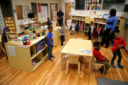 A group of students participates in learning exercises with teachers Ryan Williams and LaTrese Cowan in a Head Start classroom Wednesday at the Cincinnati-Hamilton County Community Action Agency in Bond Hill.
