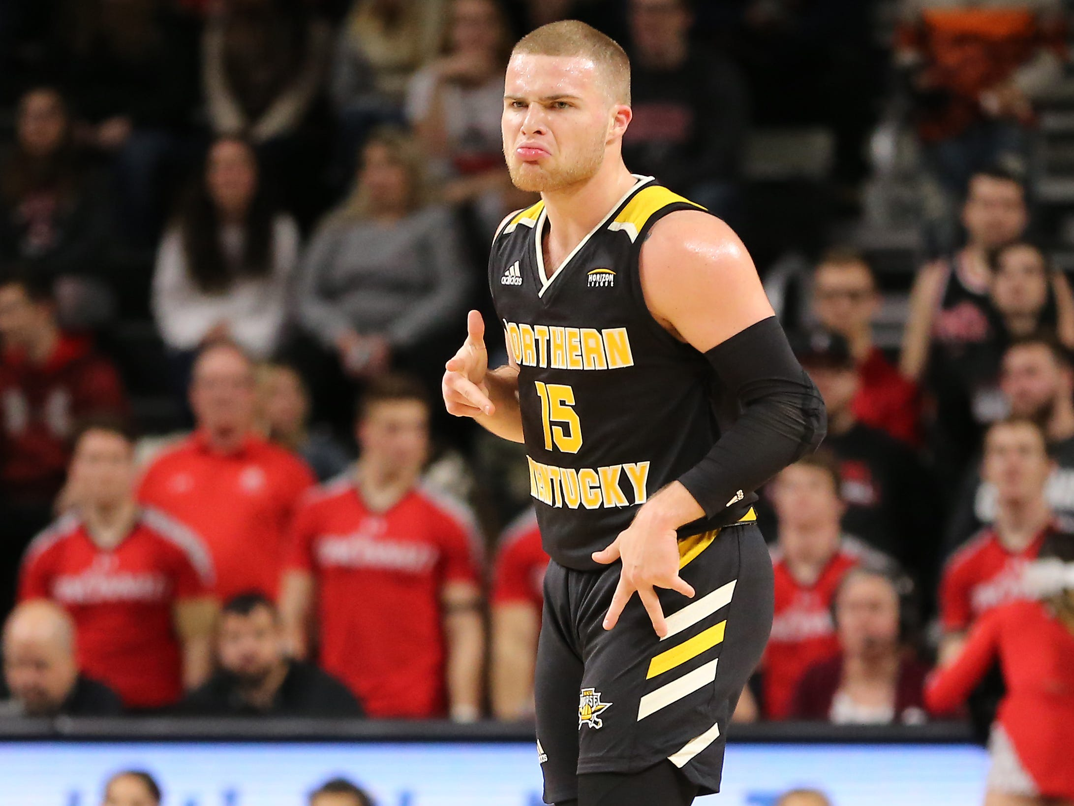 Northern Kentucky Norse guard Tyler Sharpe (15) reacts after making a 3-pointer in the first half of an NCAA college basketball against the Cincinnati Bearcats, Tuesday, Dec. 4, 2018, at Fifth Third Arena in Cincinnati.