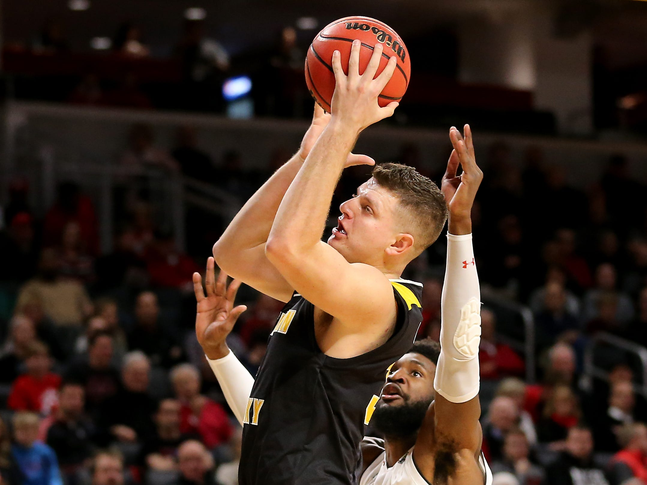 Northern Kentucky Norse forward Drew McDonald (34) collects a pass over Cincinnati Bearcats forward Eliel Nsoseme (22) in the first half of an NCAA college basketball game, Tuesday, Dec. 4, 2018, at Fifth Third Arena in Cincinnati.