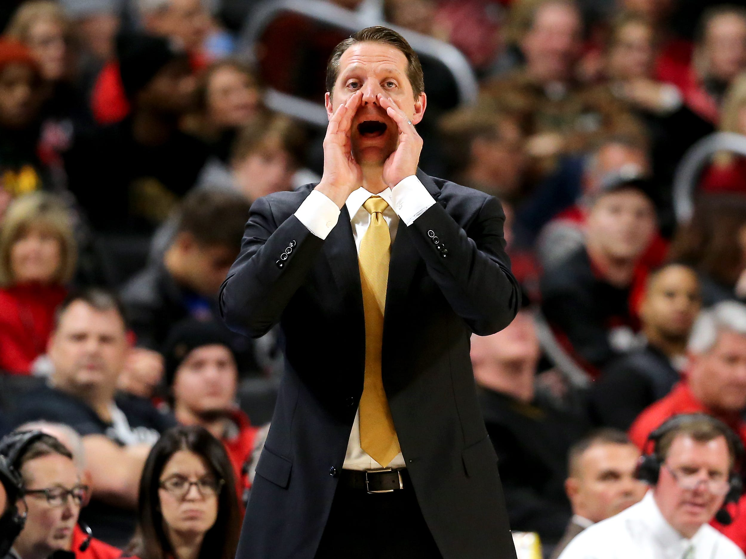 Northern Kentucky Norse head coach John Brannen instructs the team in the first half of an NCAA college basketball game against the Cincinnati Bearcats, Tuesday, Dec. 4, 2018, at Fifth Third Arena in Cincinnati.
