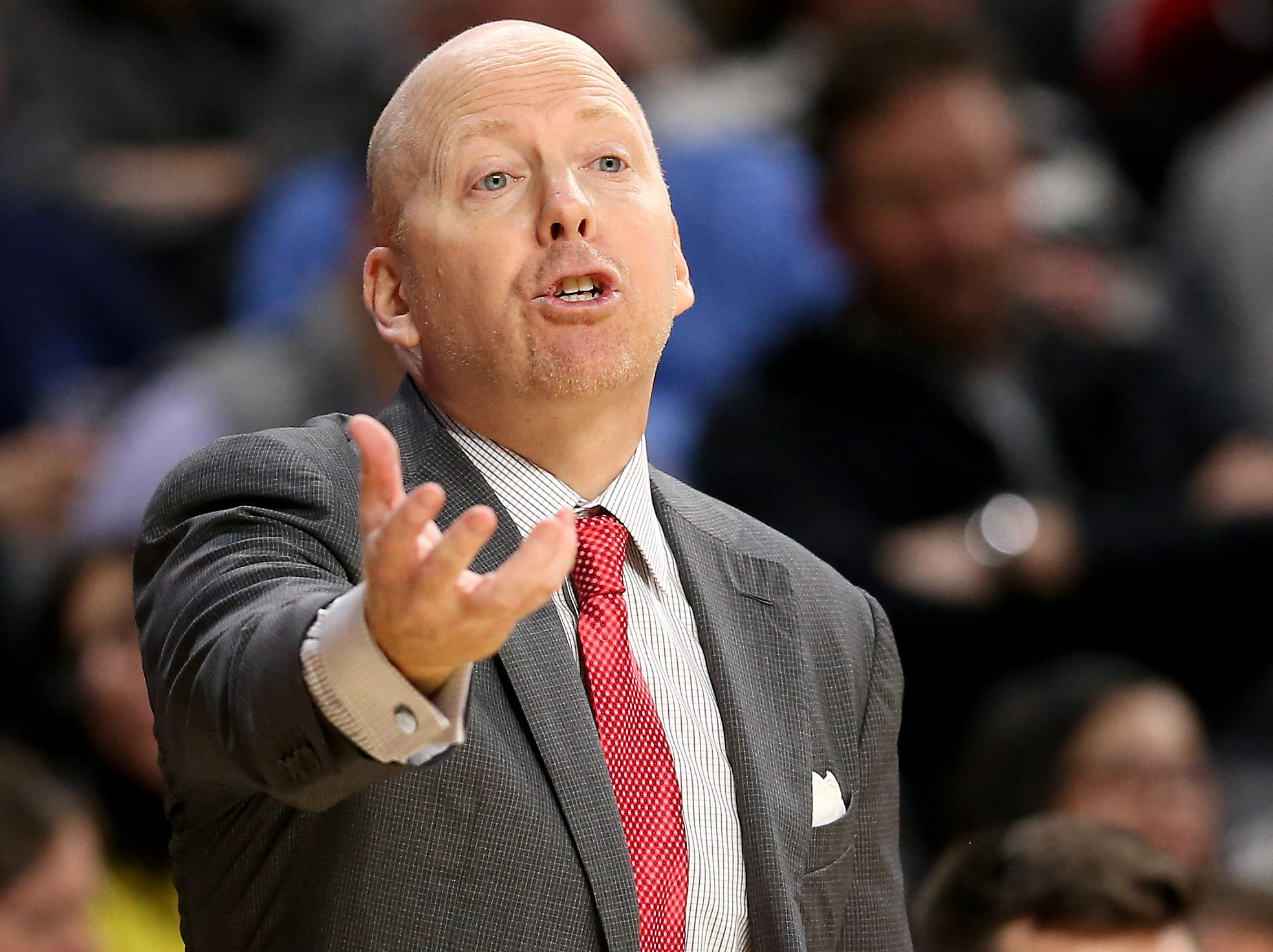 Cincinnati Bearcats head coach Mick Cronin instructs the team in the first half of an NCAA college basketball game against the Northern Kentucky Norse, Tuesday, Dec. 4, 2018, at Fifth Third Arena in Cincinnati.