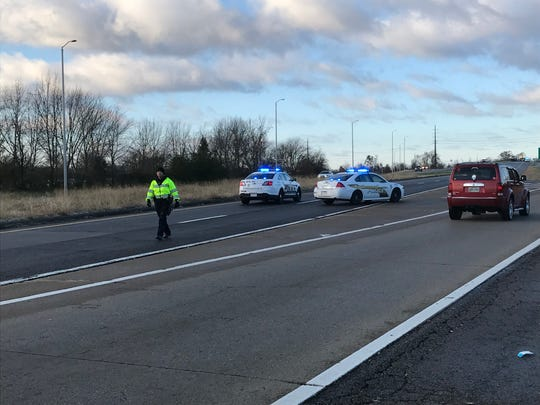 Clarksville Police block traffic on 101st Airborne Division Parkway over Fort Campbell Boulevard after several wrecks following light snow Wednesday morning, Dec. 5, 2018.