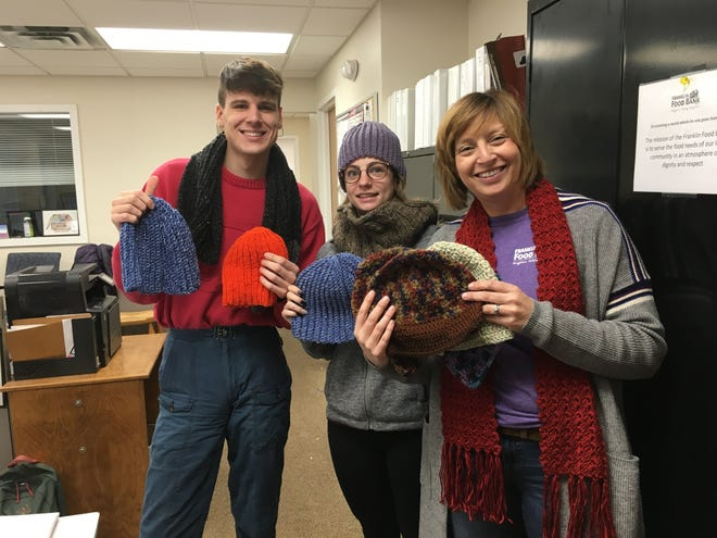 Luca Giovannetti, Selena Campopiano and Ellen Zimmerman display some of the 50 hats and additional scarves that you made for their clients this winter.