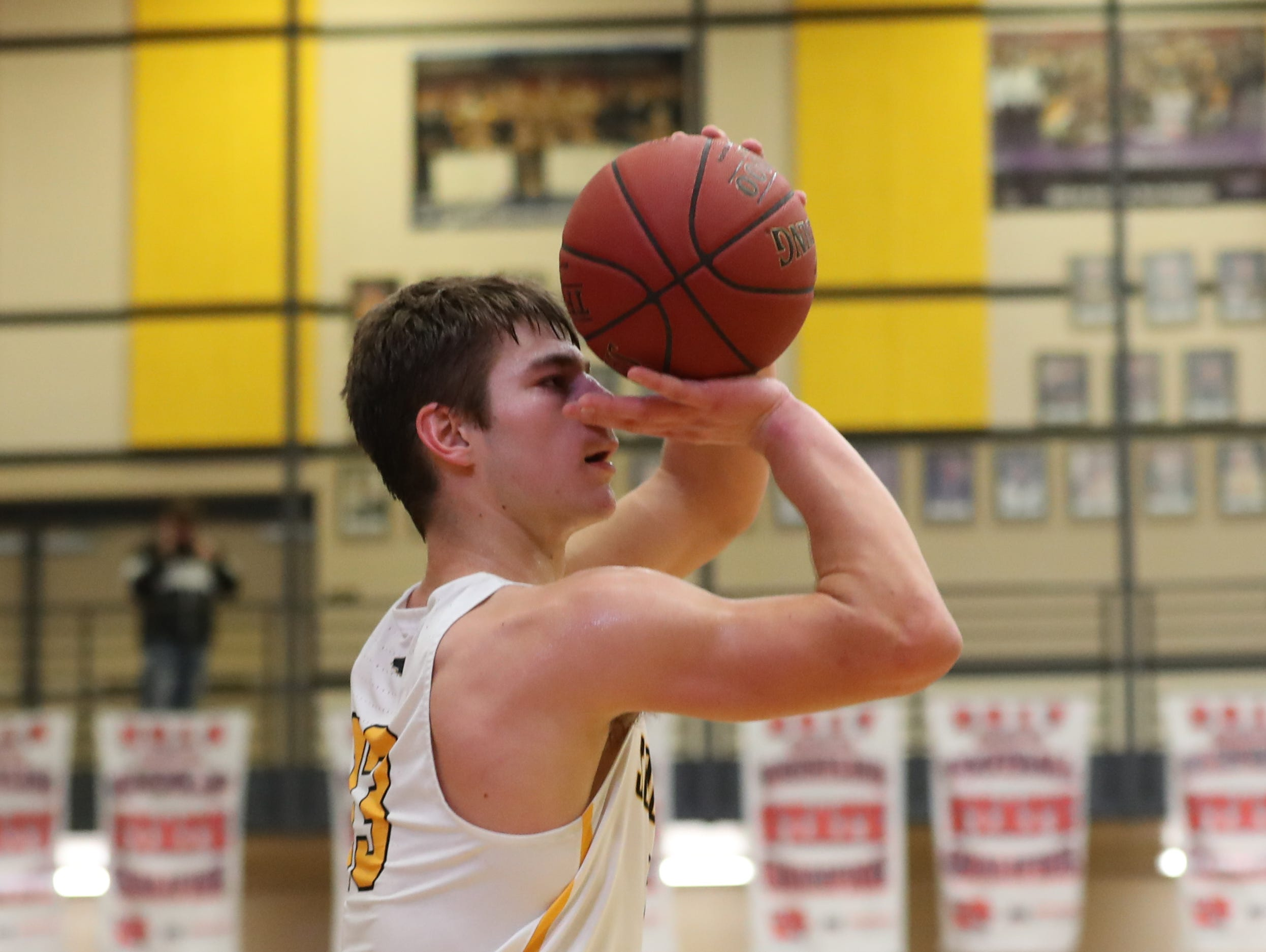 Southeast Polk Rams Dominic Caggiano (13) shoots a three against the Hoover Huskies at Southeast Polk High School.