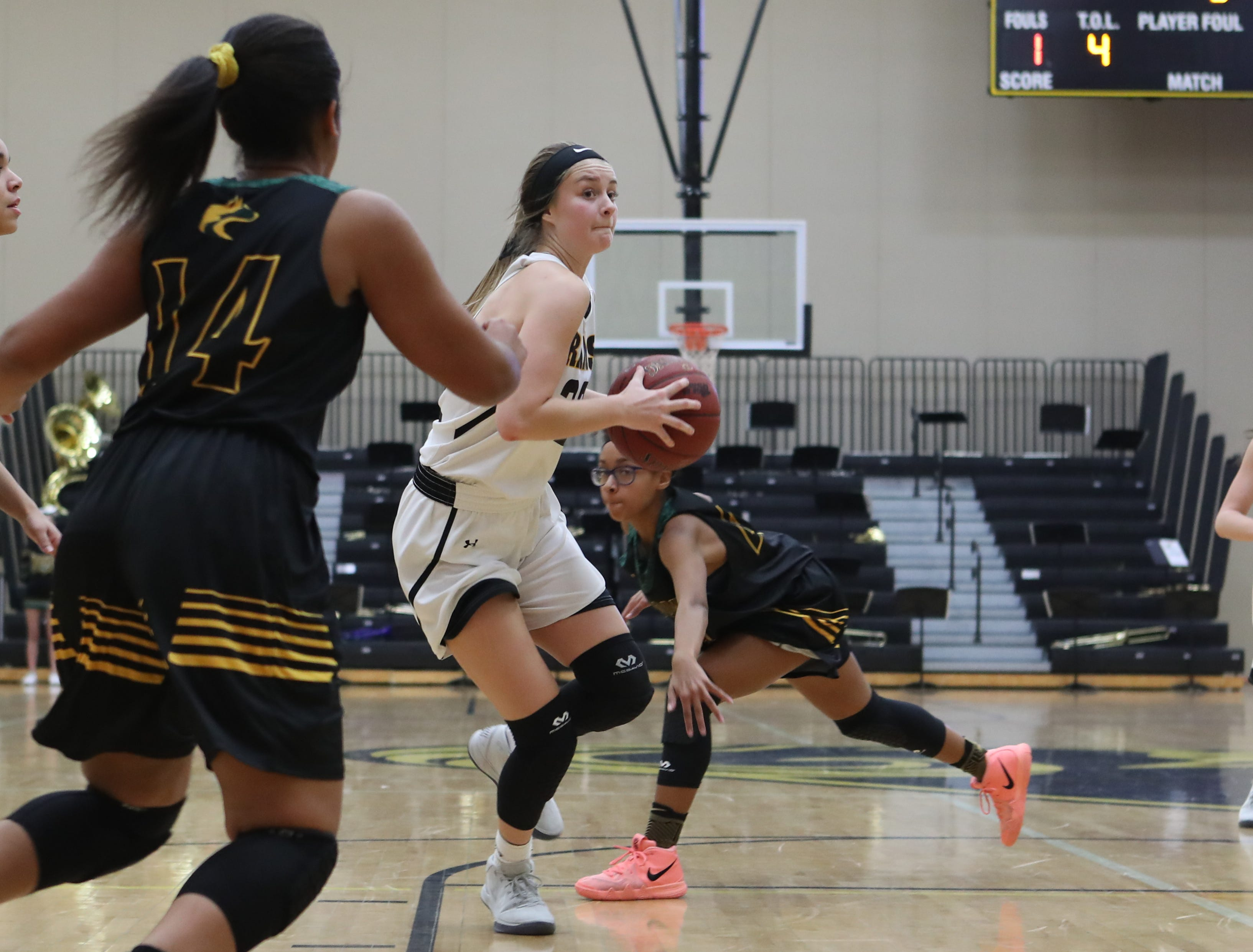 Southeast Polk Rams Maggie McGraw (32) drives the lane against the Hoover Huskies at Southeast Polk High School.