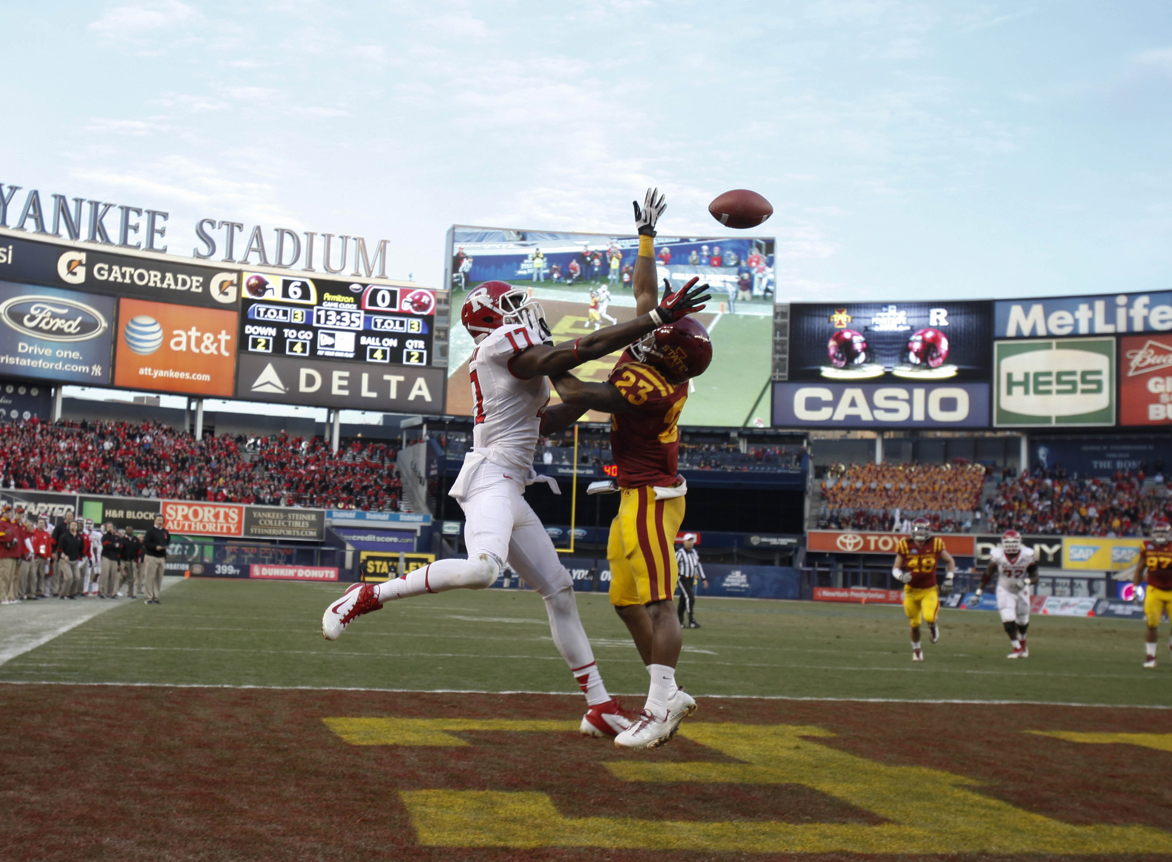 Rutgers wide receiver Brandon Coleman and Iowa State defensive back Leonard Johnson battle for the football in the end zone during the first half of the Pinstripe Bowl game played on Friday afternoon in New York City. The play ended in an incomplete pass. The Scarlet Knights beat the Cyclones 27-13.