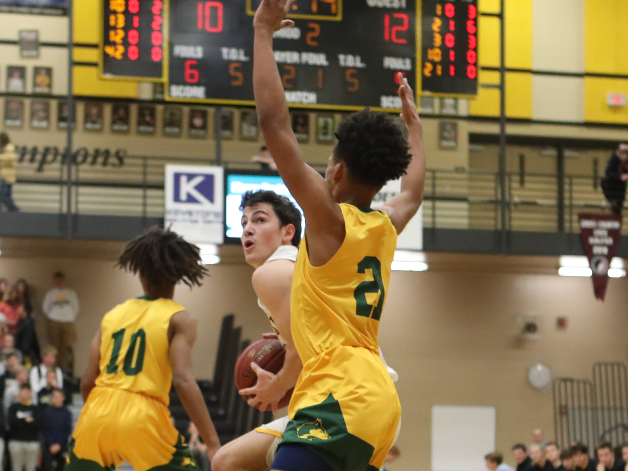 Hoover Huskies Jaden Loveless (21) defends the shot from Southeast Polk Rams Daniel Hackbarth (10) at Southeast Polk High School.