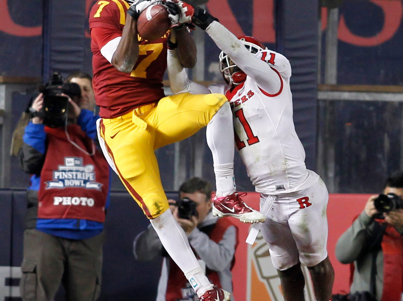 Rutgers Scarlet Knights defensive back Logan Ryan (11) knocks the pass in the end zone away from Iowa State Cyclones wide receiver Darius Reynolds (7) on fourth down in the fourth quarter of the Pinstripe Bowl at Yankee Stadium.