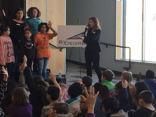 Findley Elementary Principal Barb Adams addresses fifth grade students. Students gathered to hear about the newly-established By Degrees Foundation, which announced it is breaking from the national I Have a Dream Foundation that helps prepare students in low-income areas for post-secondary education. The announcement was made at Des Moines' Findley Elementary on Wednesday, Dec. 5, 2018.