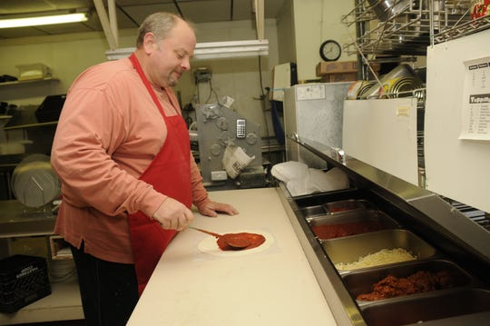 Sue Freylack's brother, Matt Freylack of Scornovacca's Ristorante whips up a handmade pizza during the lunch hour. Scorno's has been around since 1976, and its old-school style is popular in the Des Moines area.