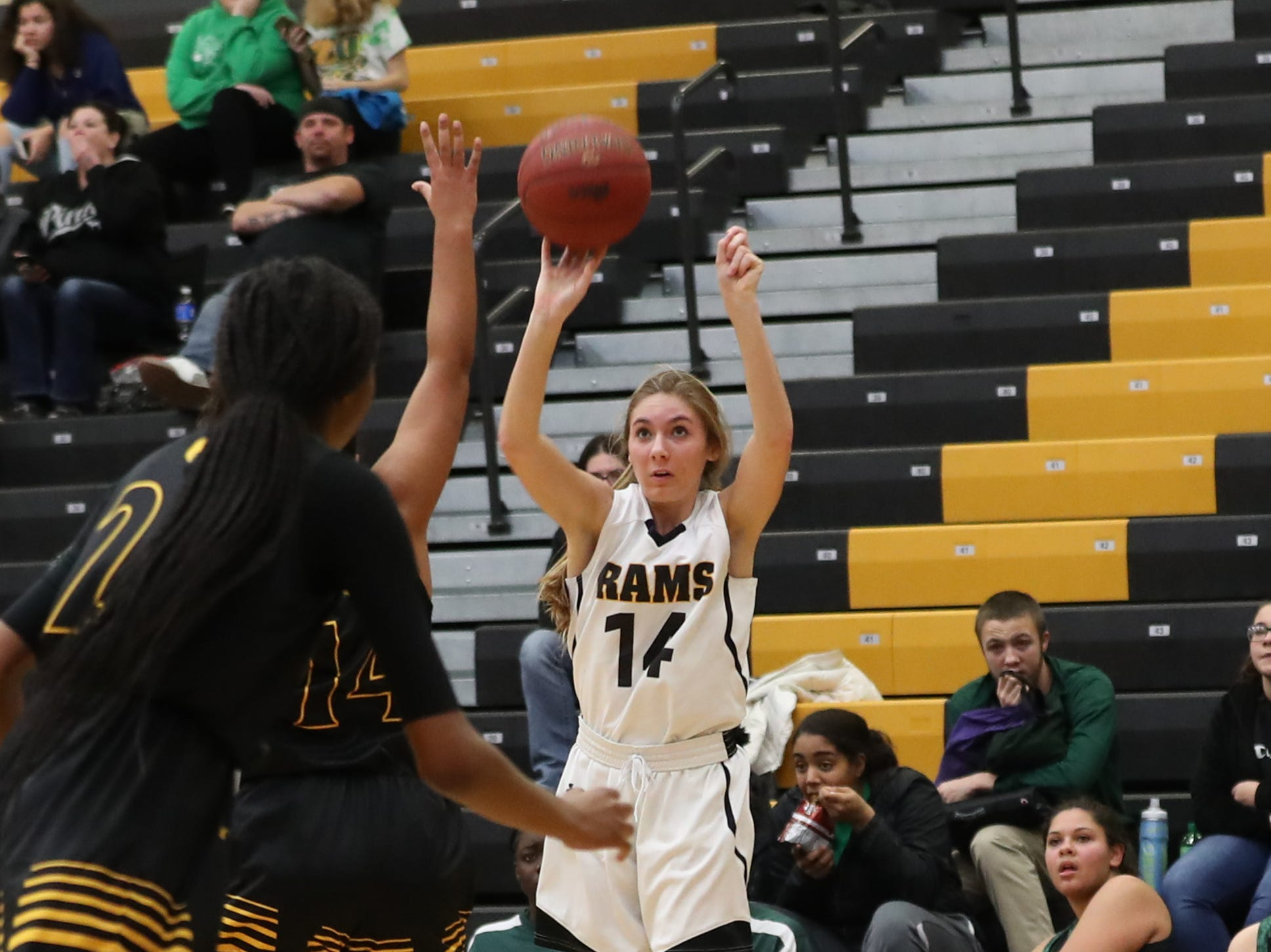 Southeast Polk Rams Jessica Stuart (14) shoots a three pointer against the Hoover Huskies at Southeast Polk High School.