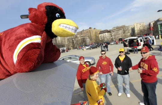 Cy, the Iowa State mascot, sits on top of a vehicle as fans tailgate at Yankee Stadium in the Bronx before the 2011 Pinstripe Bowl.