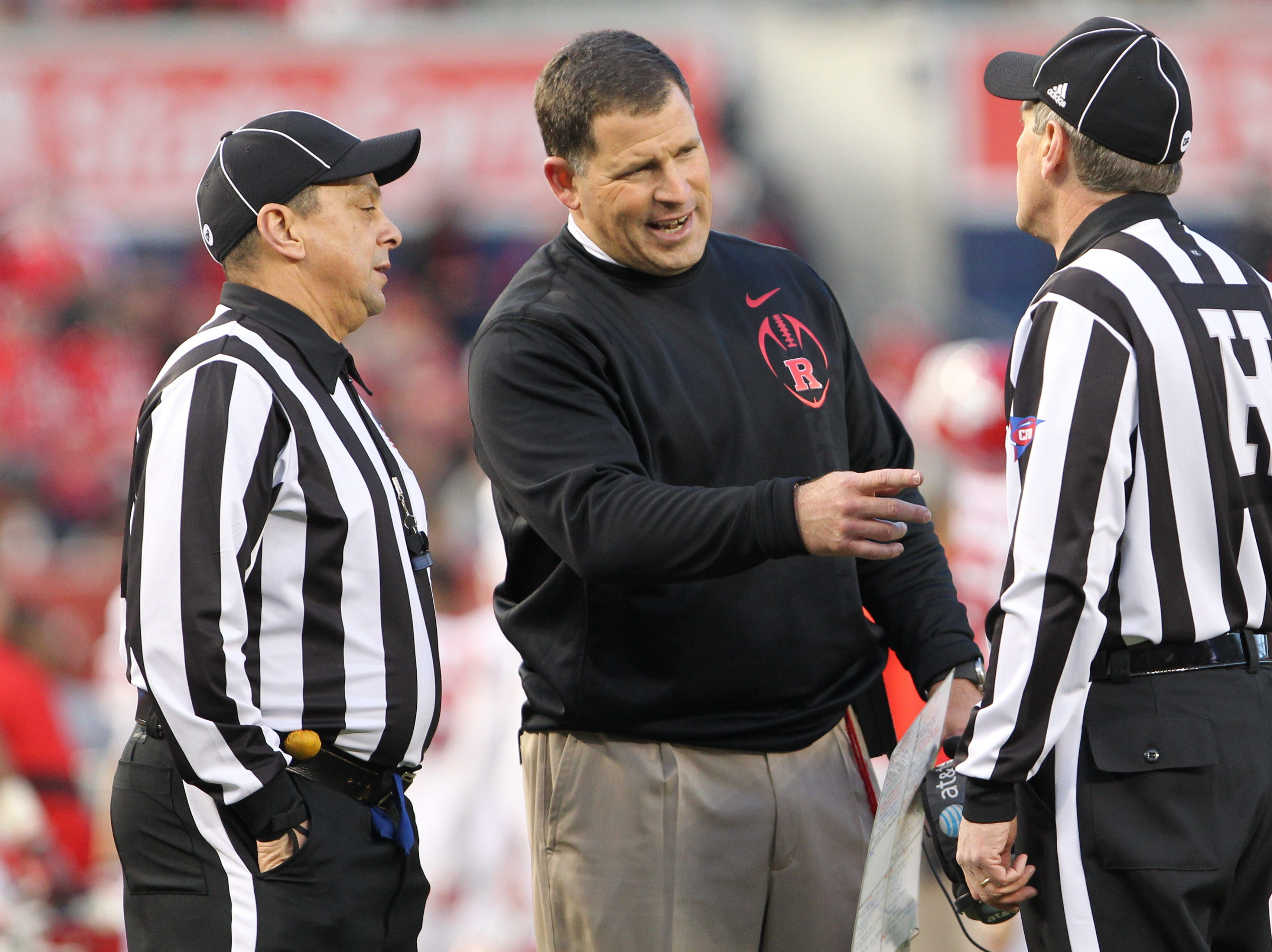 Rutgers head coach Greg Schiano discusses a call with the referee's during the first quarter against the Iowa State Cyclones of the 2011 Pinstripe Bowl at Yankee Stadium.