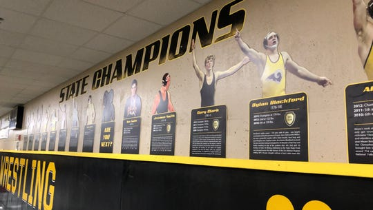 The Southeast Polk wrestling room displays the program's history. Here, the past state champions are shown.