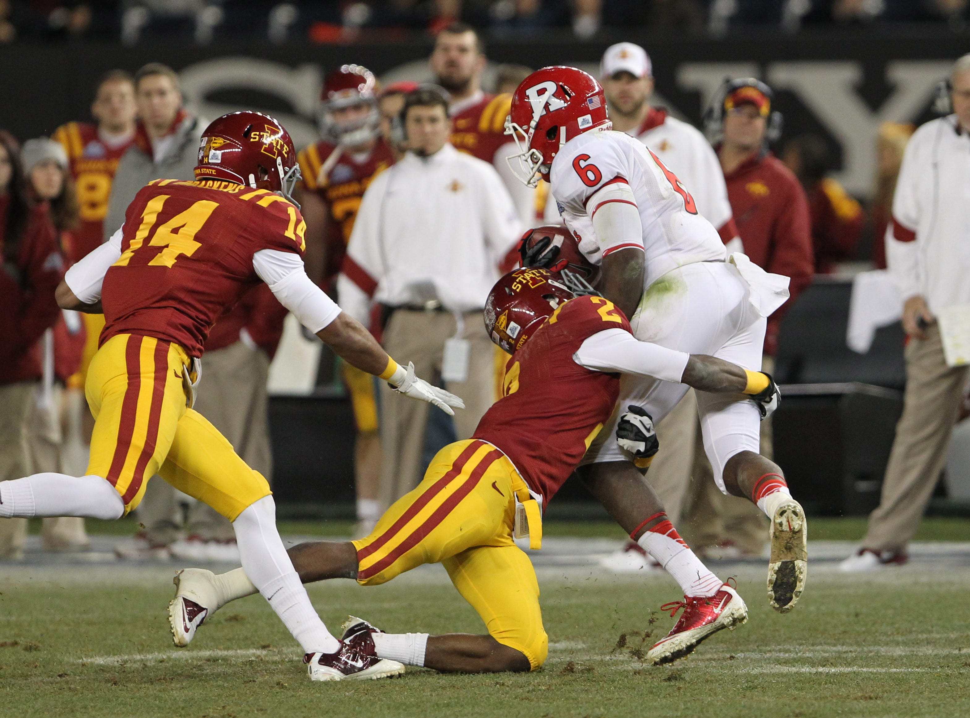 Iowa State Cyclones defensive back Jansen Watson (2) tackles Rutgers Scarlet Knights wide receiver Mohamed Sanu (6) during the third quarter of the 2011 Pinstripe Bowl at Yankee Stadium. Rutgers won 27 - 13.