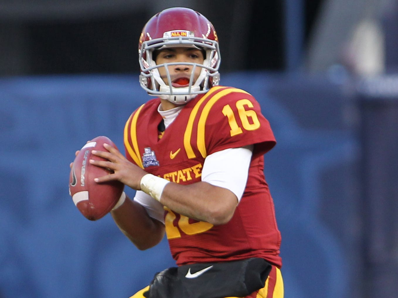 Iowa State Cyclones quarterback Jared Barnett (16) sends a pass during the first quarter against the Rutgers Scarlet Knights at the 2011 Pinstripe Bowl at Yankee Stadium.