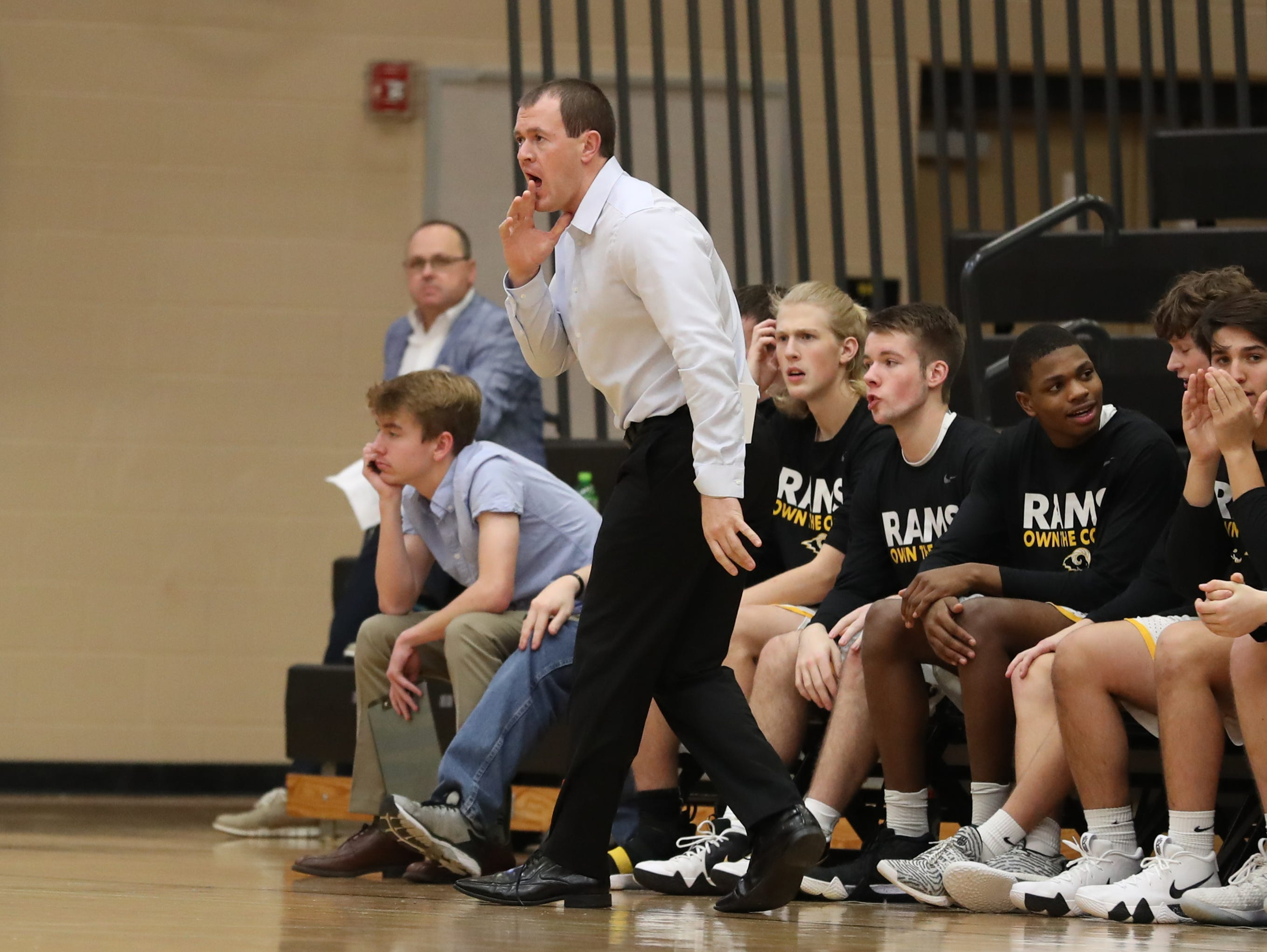 Southeast Polk Rams Head Coach Alan Jenkins talks to his team during their game with the Hoover Huskies at Southeast Polk High School.