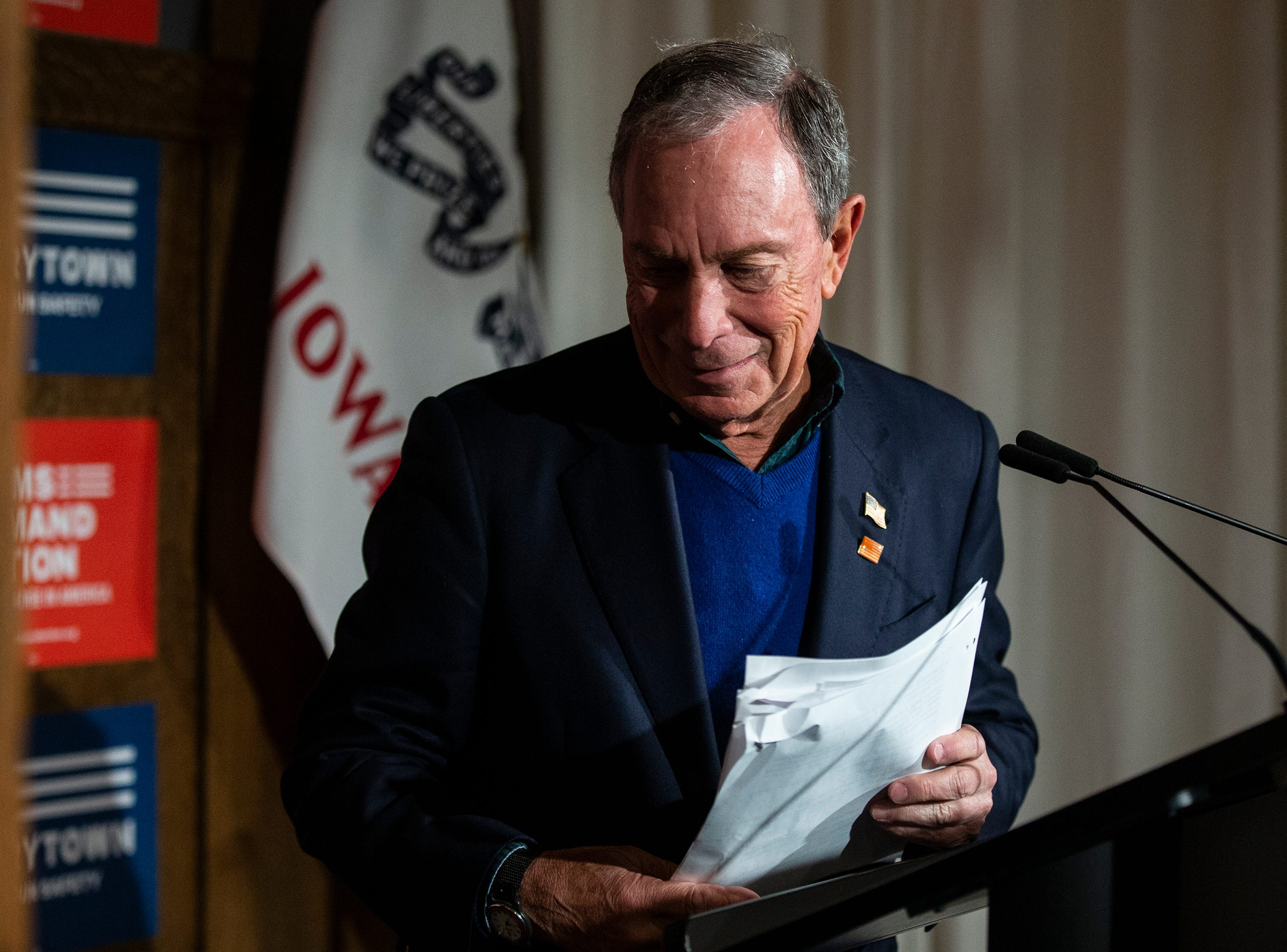 Former New York City Mayor Michael Bloomberg leaves the stage after speaking to the crowd gathered at an Iowa Moms Demand Action member meeting on Tuesday, Dec. 4, 2018, at the Iowa Taproom in Des Moines.