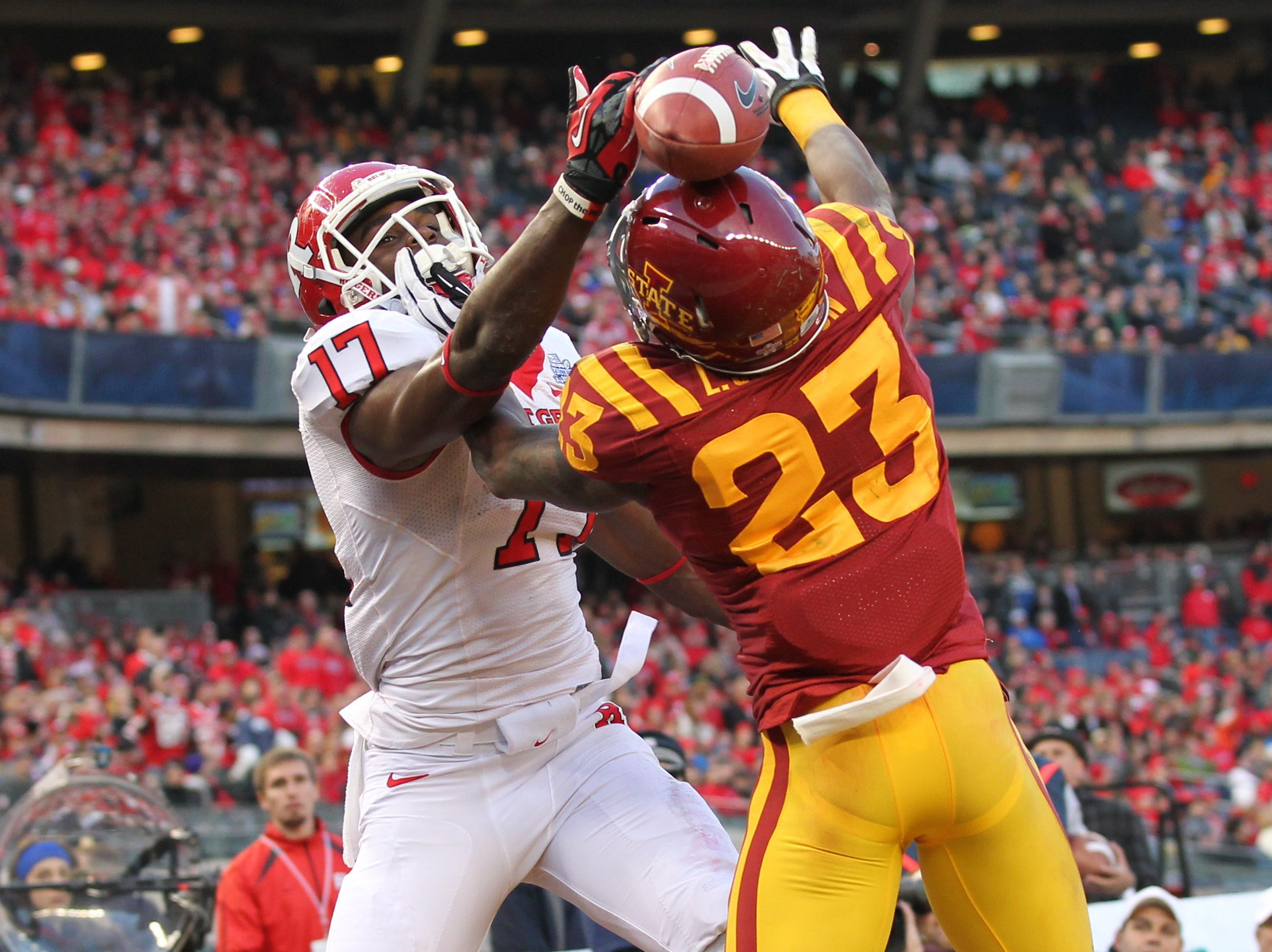 Rutgers Scarlet Knights wide receiver Brandon Coleman (17) misses a catch against Iowa State Cyclones defensive back Leonard Johnson (23) during the second quarter of the 2011 Pinstripe Bowl at Yankee Stadium.