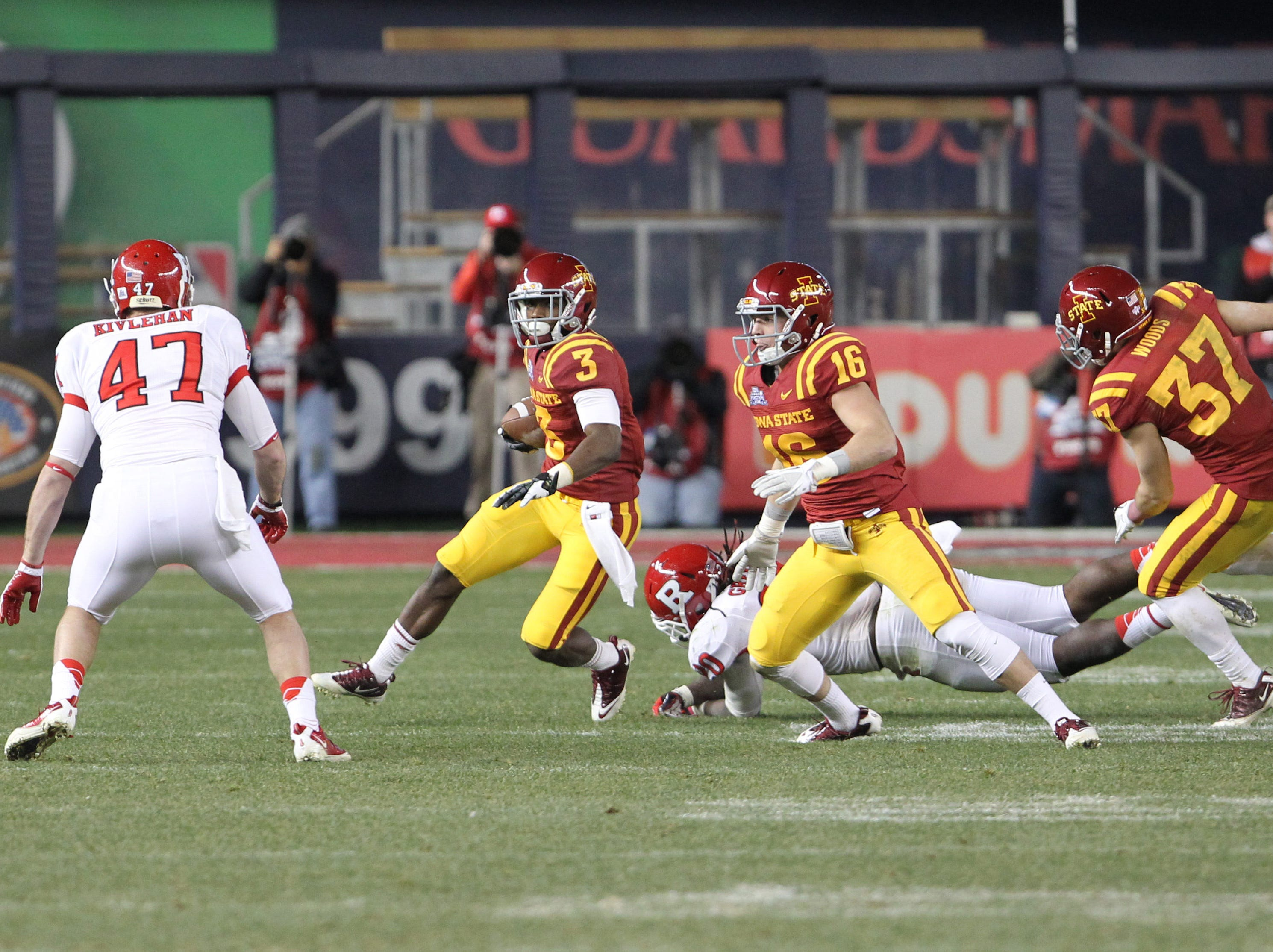 Iowa State Cyclones wide receiver Aaron Horne (3) carries the ball as Rutgers Scarlet Knights defensive back Patrick Kivlehan (47) looks to block during the third quarter of the 2011 Pinstripe Bowl at Yankee Stadium. Rutgers won 27-13.