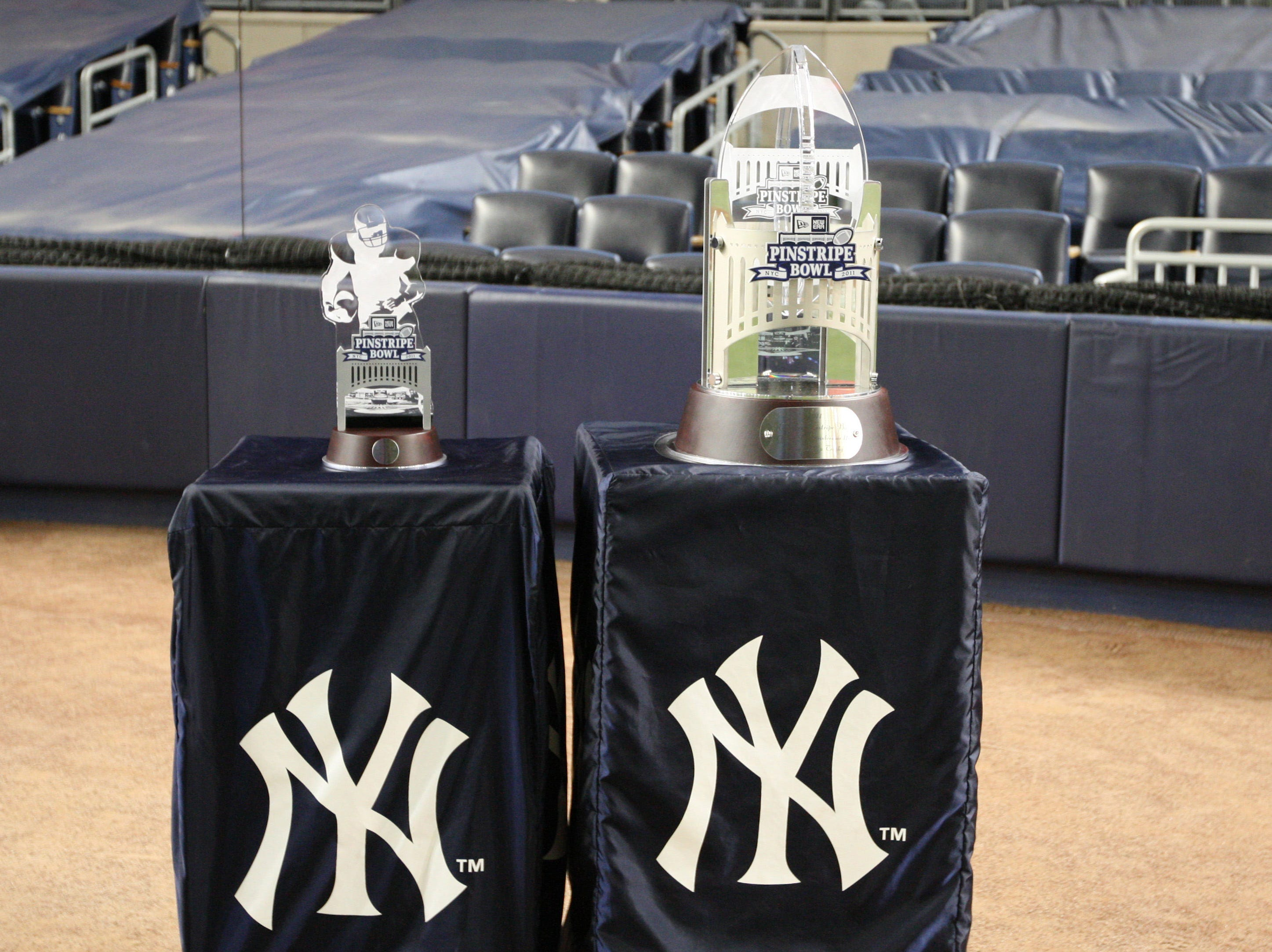 Trophies for the 2011 Pinstripe Bowl between the Rutgers Scarlet Knights and the Iowa State Cyclones at Yankee Stadium. Rutgers won 27 - 13.