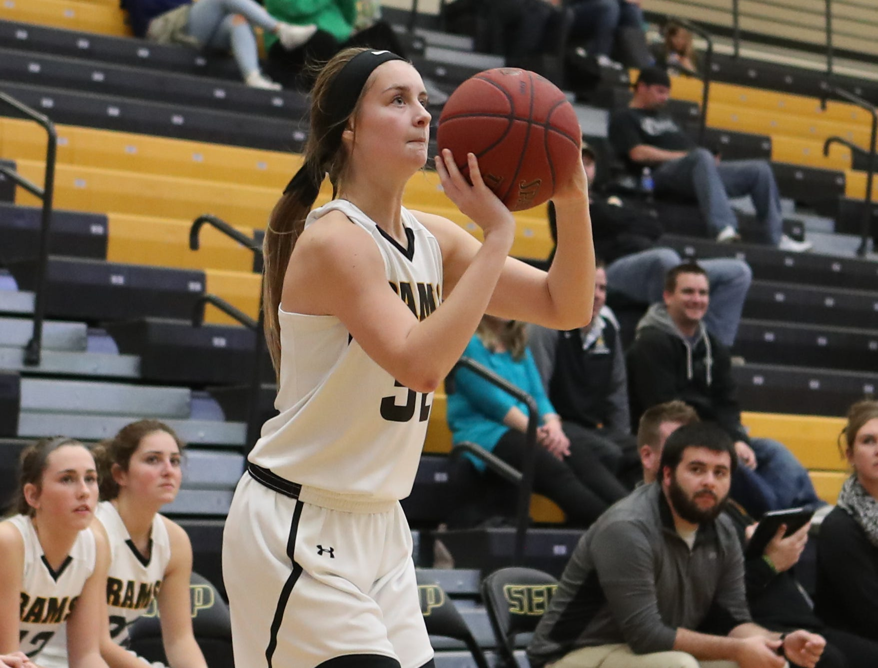 Southeast Polk Rams Maggie McGraw (32) shoots a three against the Hoover Huskies at Southeast Polk High School.