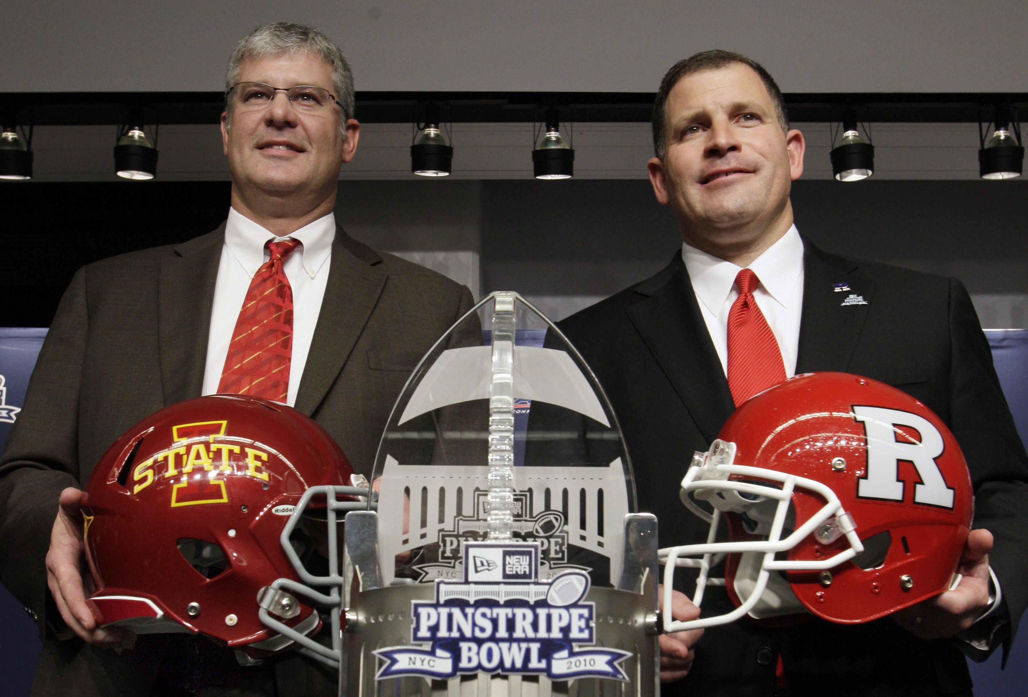 Rutgers coach Greg Schiano, right, and Iowa State coach Paul Rhoads pose for photos during an NCAA college football news conference at New York's Yankee Stadium,  Wednesday, Dec. 7, 2011. The two teams are slated to meet in the New Era Pinstripe Bowl at the stadium on Dec. 30, 2011.