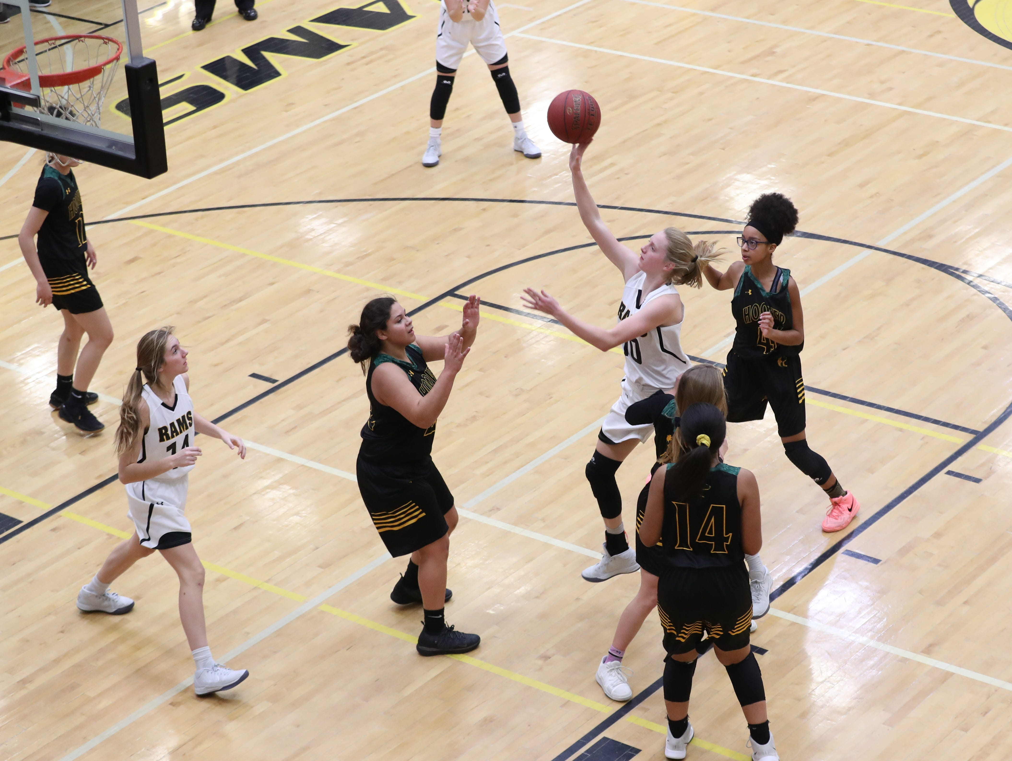 Southeast Polk Rams Grace Larkins (10) drives the lane for two points against the Hoover Huskies at Southeast Polk High School.