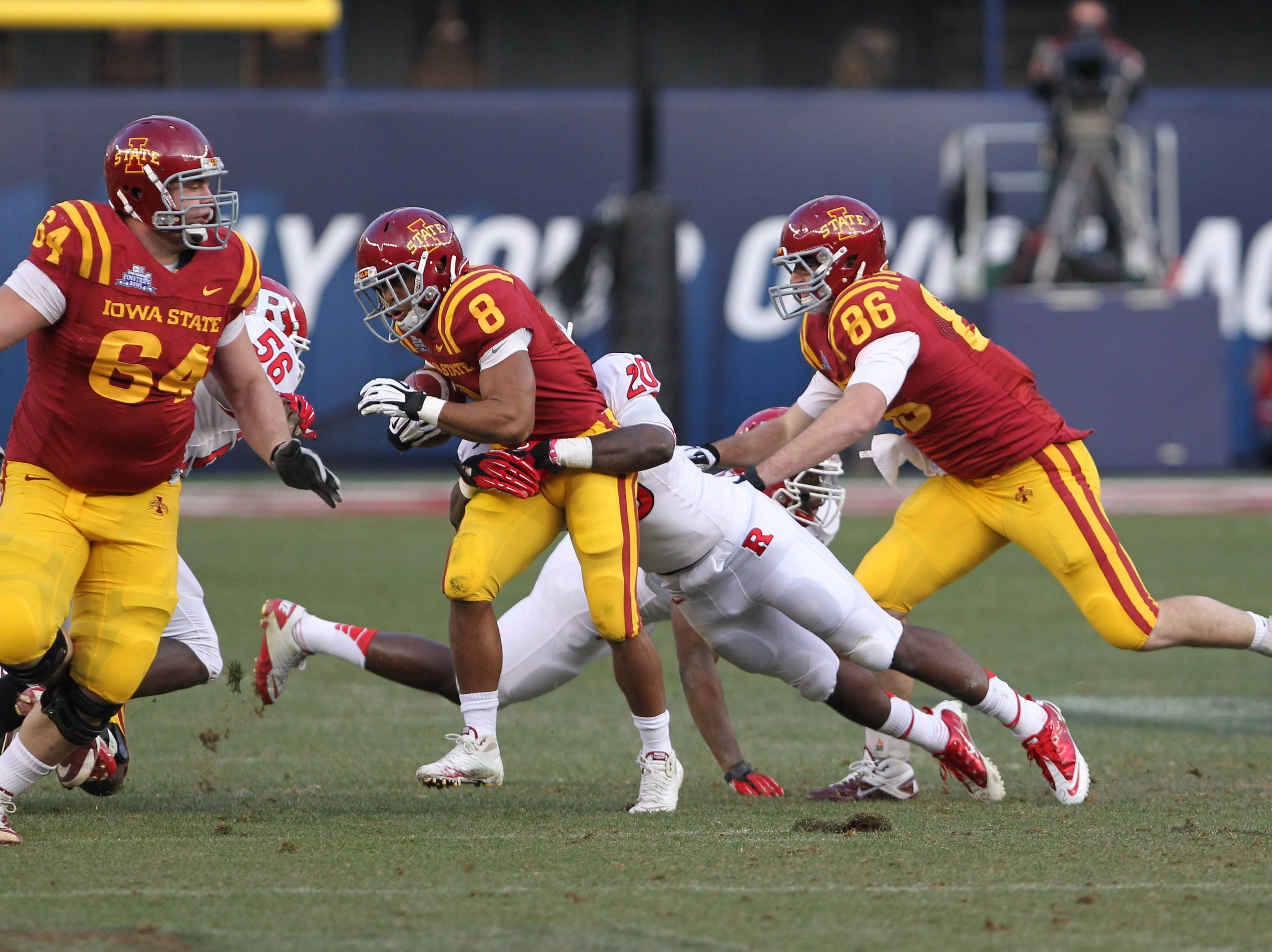 Iowa State Cyclones running back James White (8) carries the ball as Rutgers Scarlet Knights defensive back Khaseem Greene (20) comes in for the tackle during the first quarter of the 2011 Pinstripe Bowl at Yankee Stadium.