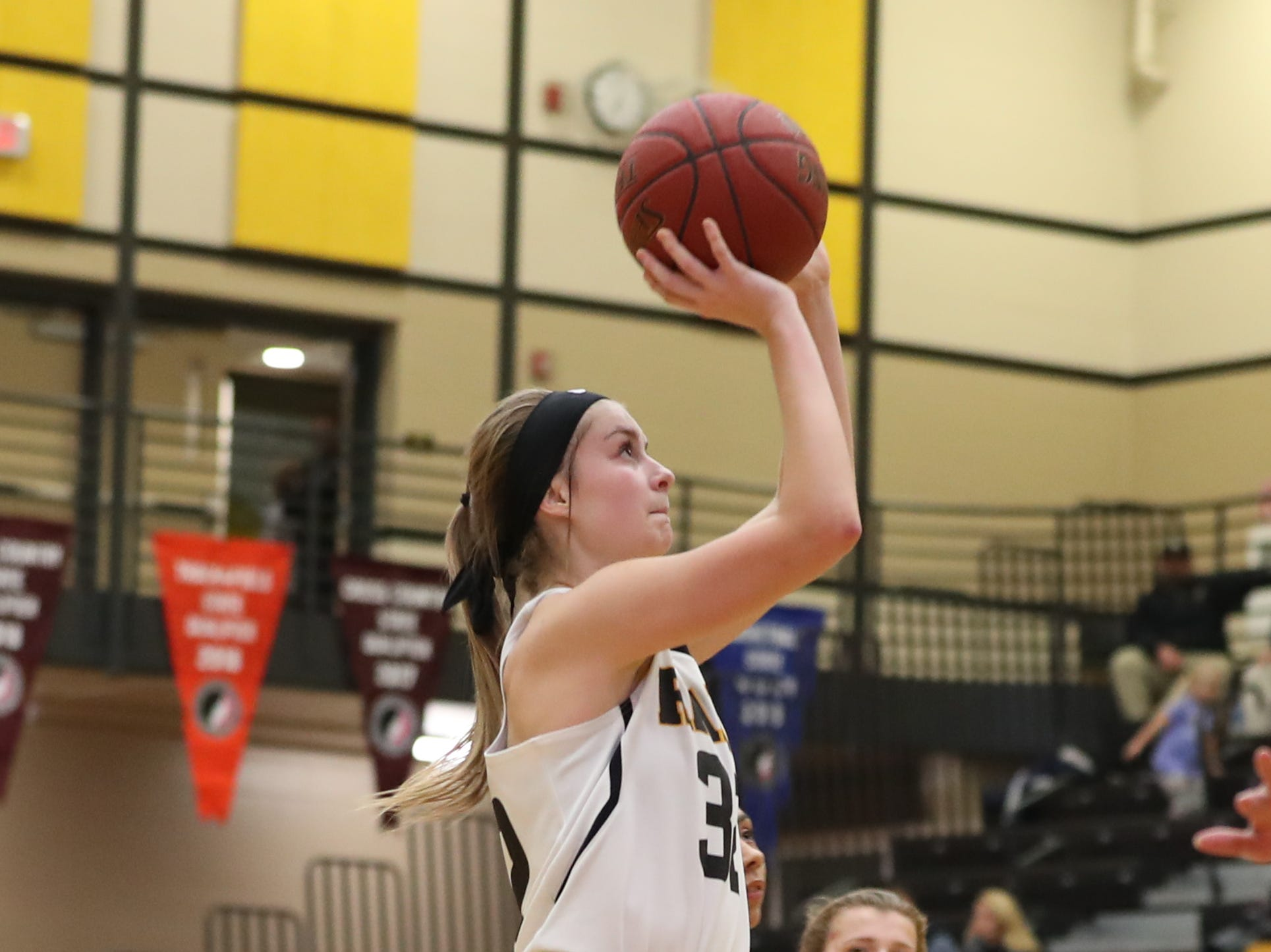 Southeast Polk Rams Maggie McGraw (32) shoots against the Hoover Huskies at Southeast Polk High School.