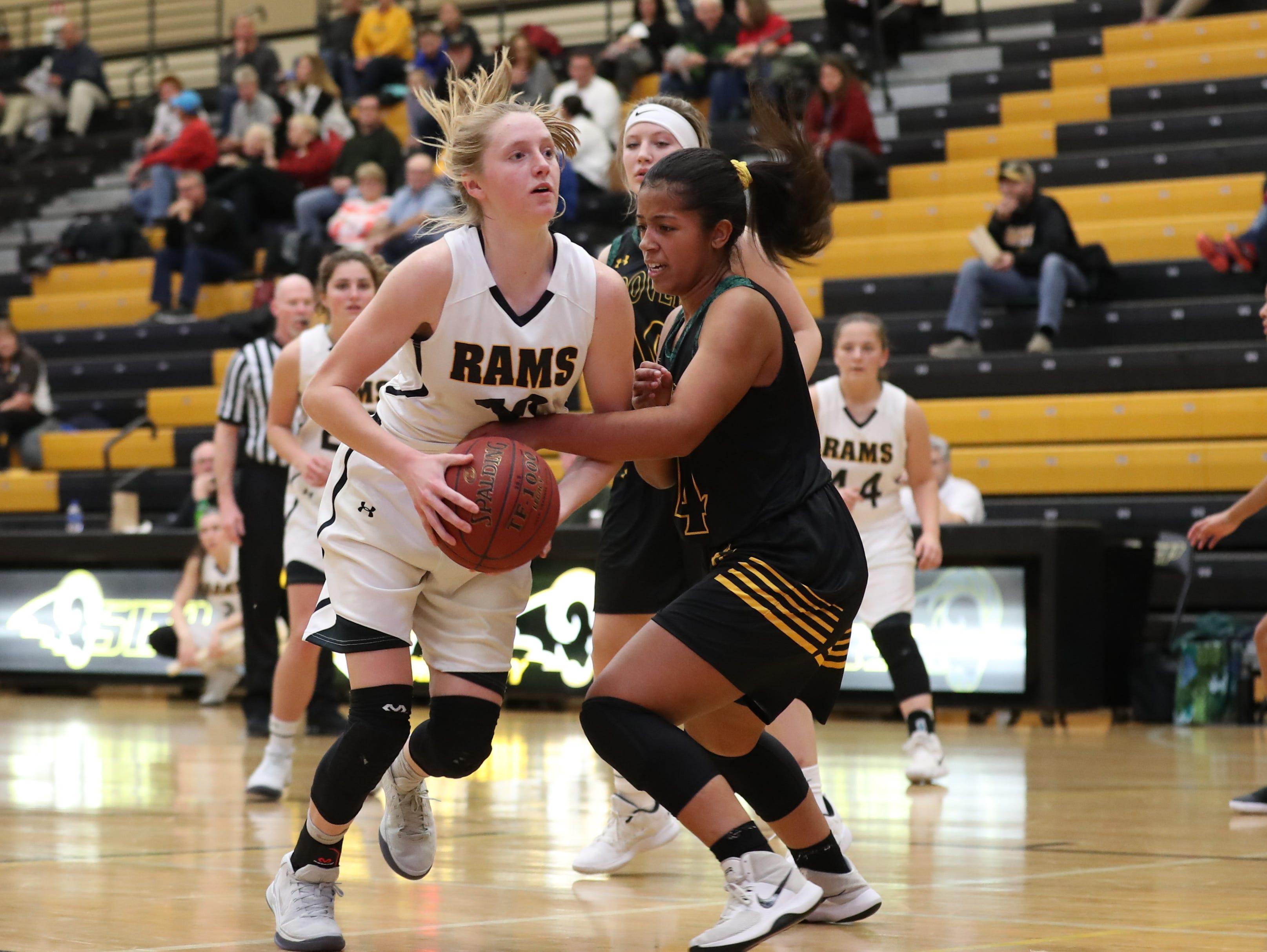 Southeast Polk Rams Grace Larkins (10) drives to the basket against the Hoover Huskies at Southeast Polk High School.